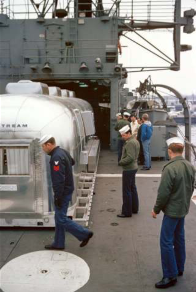 Apollo 11 Airstream offloaded onto USS Hornet